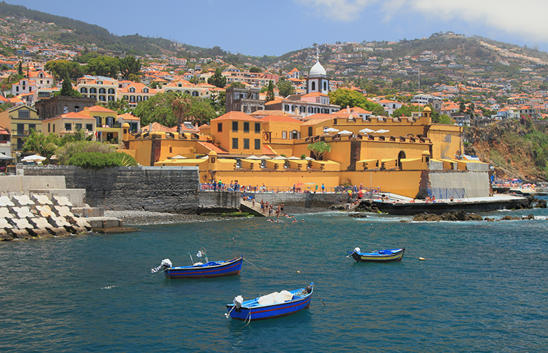 Madeira-Funchal-Fishing boats, city beach and ancient fortress-1