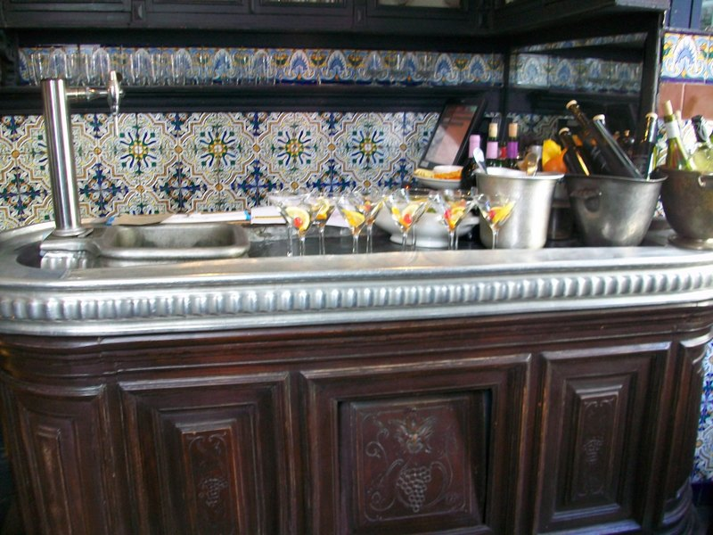 Spain holiday guide community of Madrid-taverna bar with glasses of vermouth