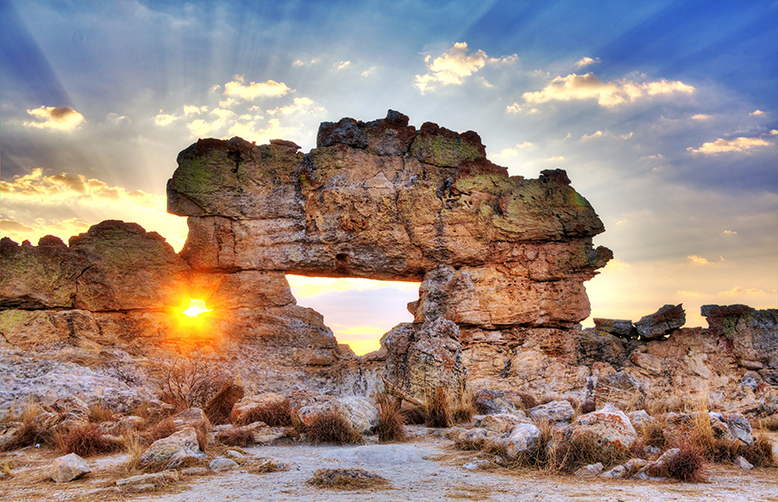 Madagascar-Sunset at 'La Fenetre'the famous rock formation near Isalo