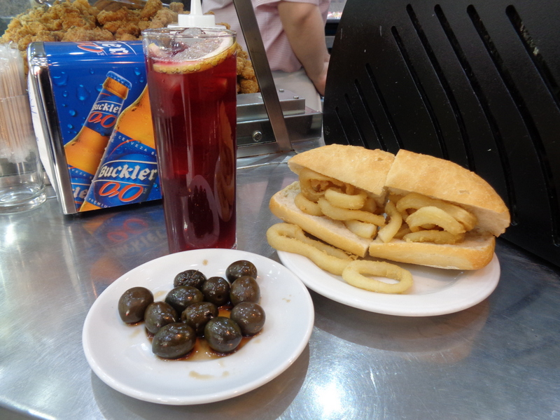 Spain travel guide community of Madrid--calamari sandwich, with olives and summer wine