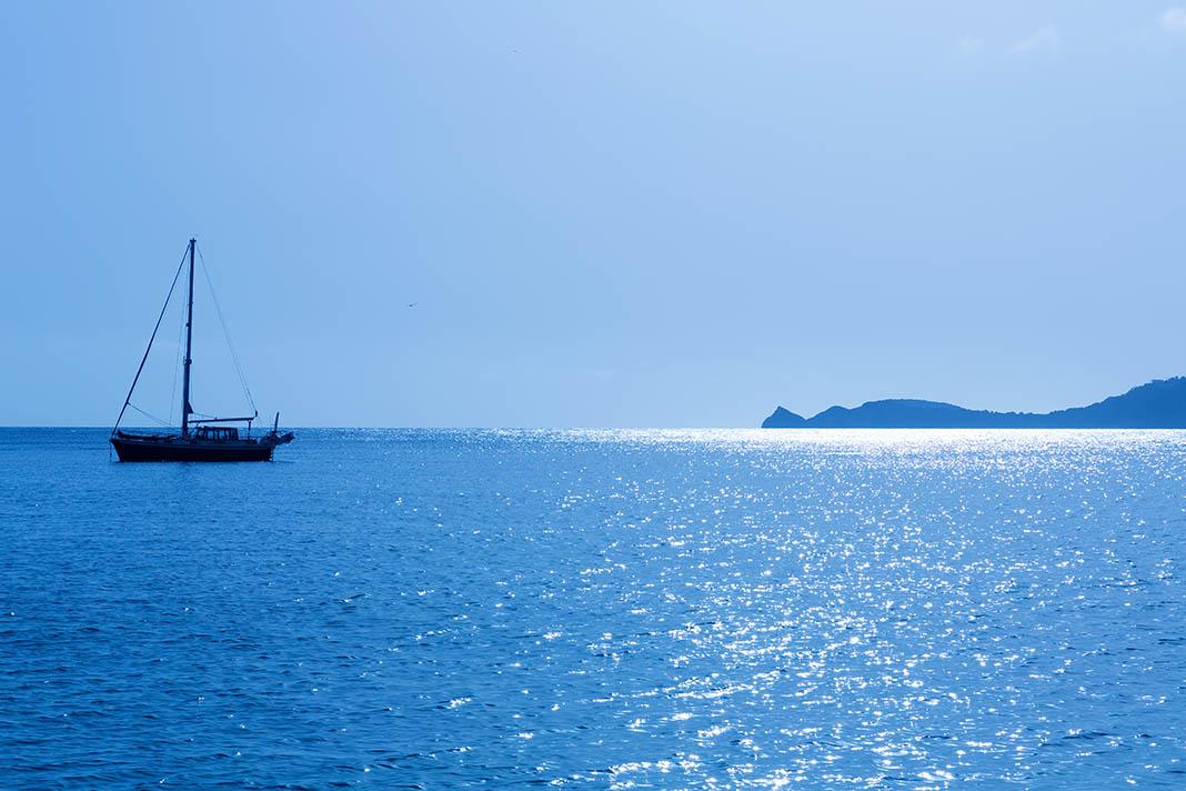 Javea Boat On Glittering Sea In Morning Light