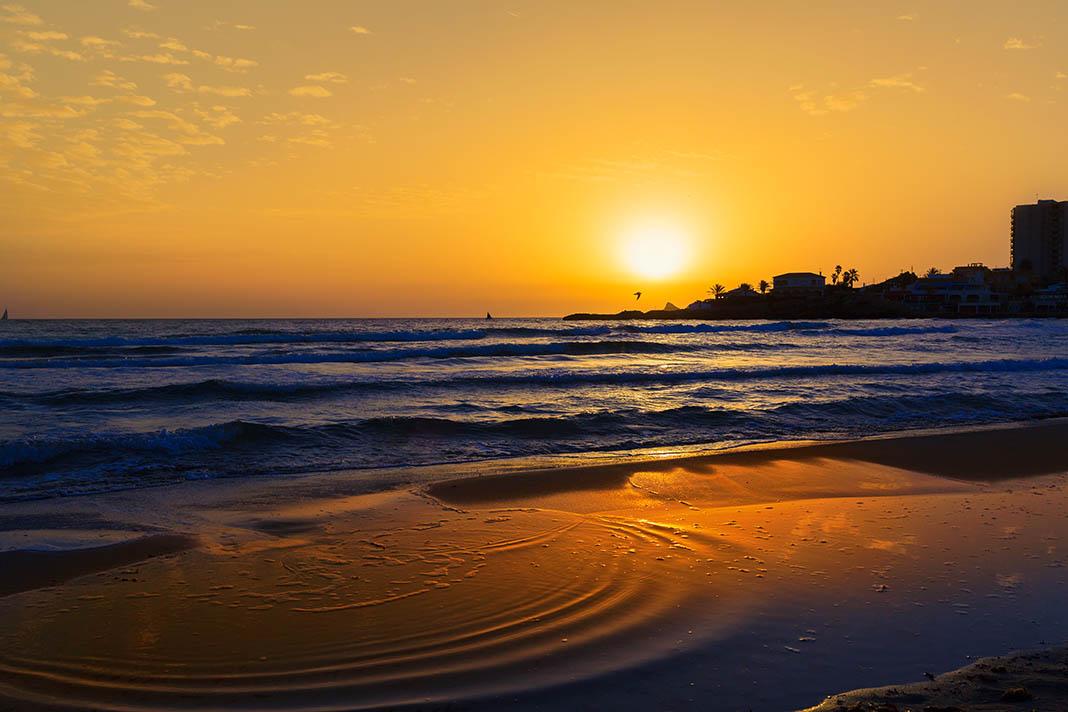 Javea Spain relocation El Arenal beach sunrise Costa Blanca