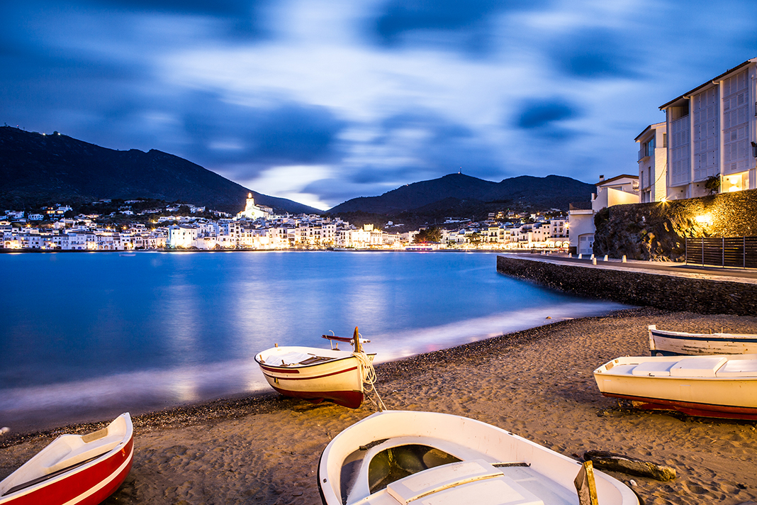 https://travelinspires.org/wp-content/uploads/2018/04/Dali-Triangle-Cadaques-Costa-Brava-Fishing-Boats.jpg