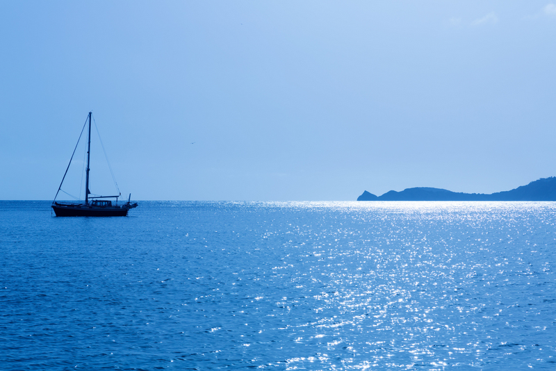 Javea Spain Boat On Glittering Sea In Morning Light