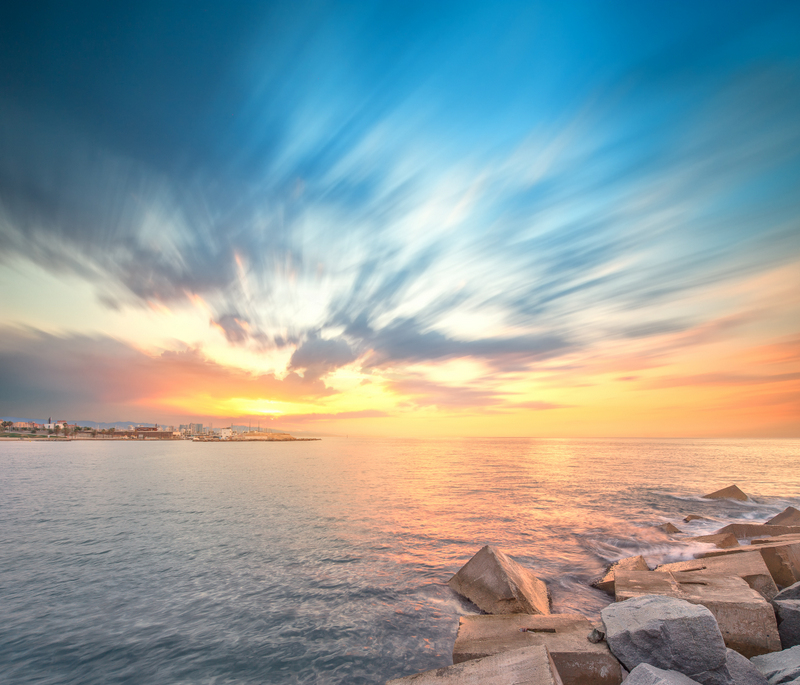 Barcelona Barceloneta Beach with colorful sky at sunrise