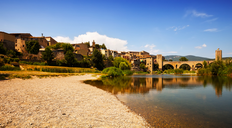 Besalu Spain antique bridge over river Fluvia Catalonia
