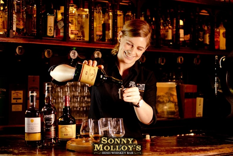 Galway Whiskey trail Sonny Molloy's smiling bartender