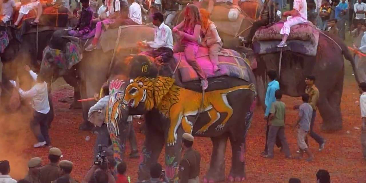 https://travelinspires.org/wp-content/uploads/2019/10/Holi-Festival-Jaipur-India1-1280x640.jpg