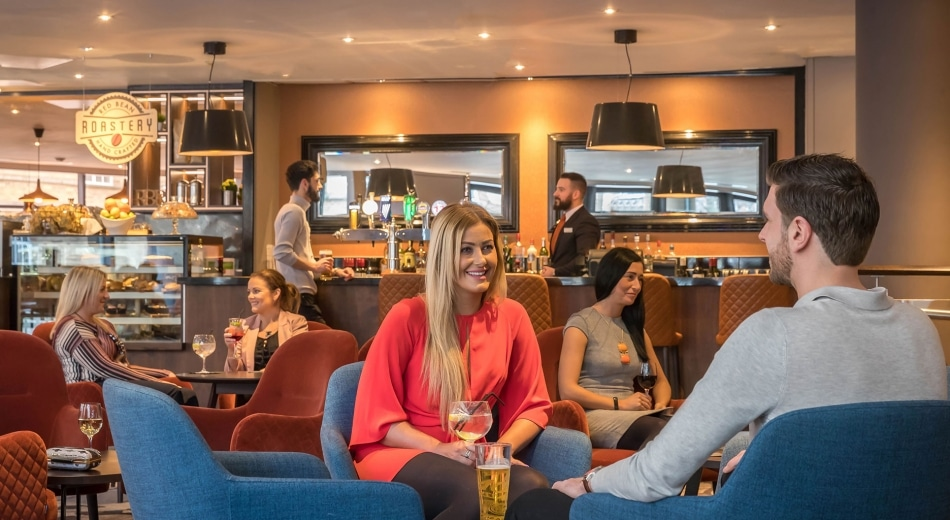 https://travelinspires.org/wp-content/uploads/2020/02/Clayton-Hotel-Belfast-bar-with-people.jpg