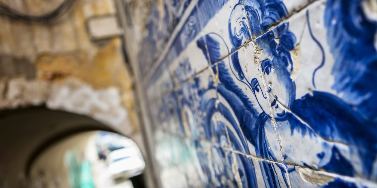 https://travelinspires.org/wp-content/uploads/2020/02/Lisbon-a-city-of-ceramics-An-angel-figure-in-azulejo-tiles-1280x640.jpg