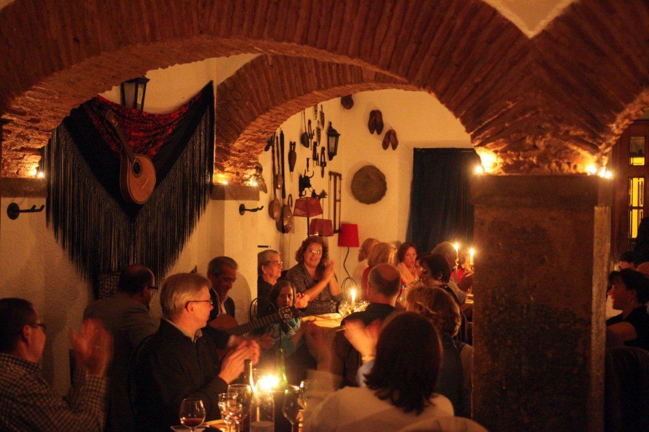https://travelinspires.org/wp-content/uploads/2020/02/Lisbon-fado-music-Alfama-district-Live-fado-music-in-a-Fado-Restaurant-1280x853.jpg