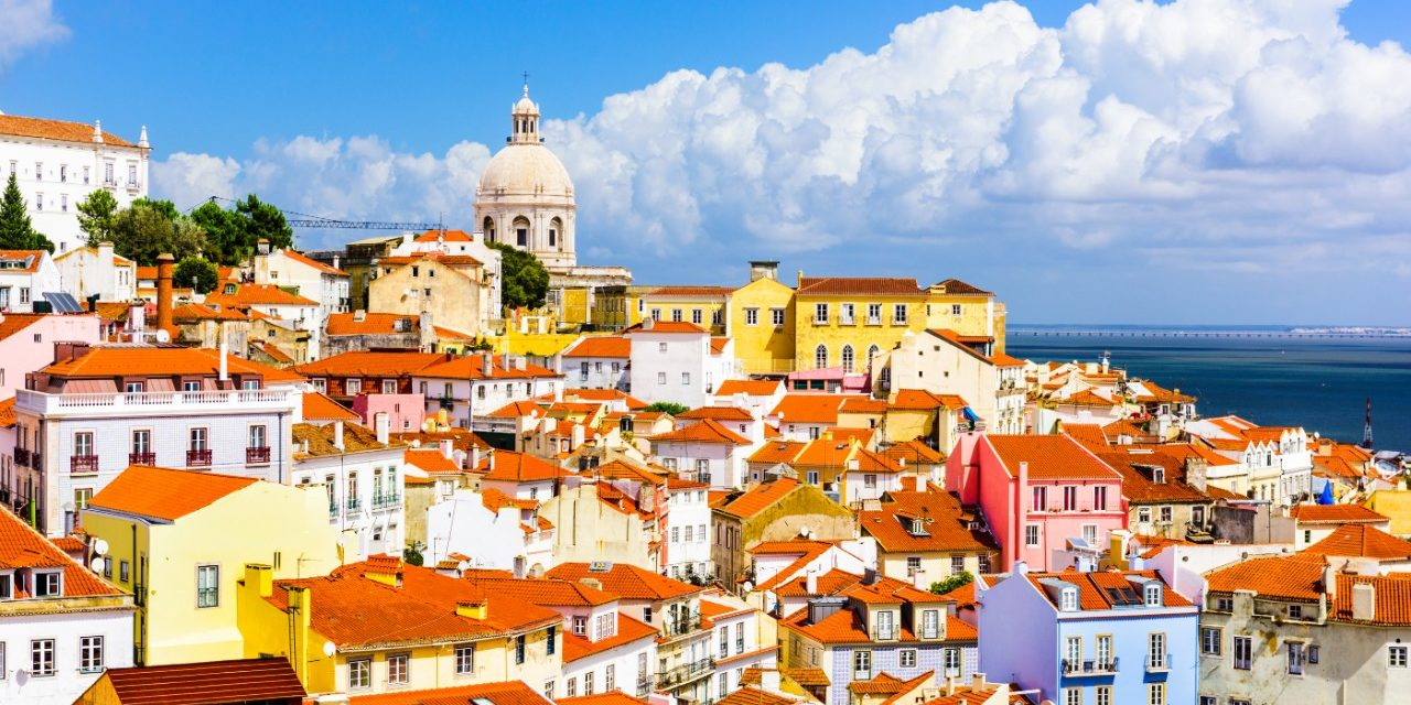 https://travelinspires.org/wp-content/uploads/2020/03/Lisbon-sustainable-destination-Alfama-Lisbon-skyline-1280x640.jpg