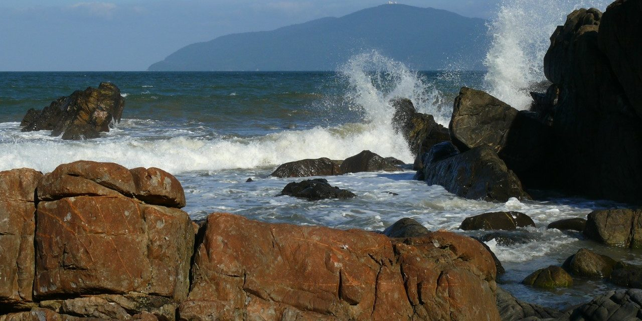 https://travelinspires.org/wp-content/uploads/2020/05/What-Vietnam-doesnt-want-us-to-see-Waves-against-the-rocks-Danang-by-Robert-Bociaga-1280x640.jpg