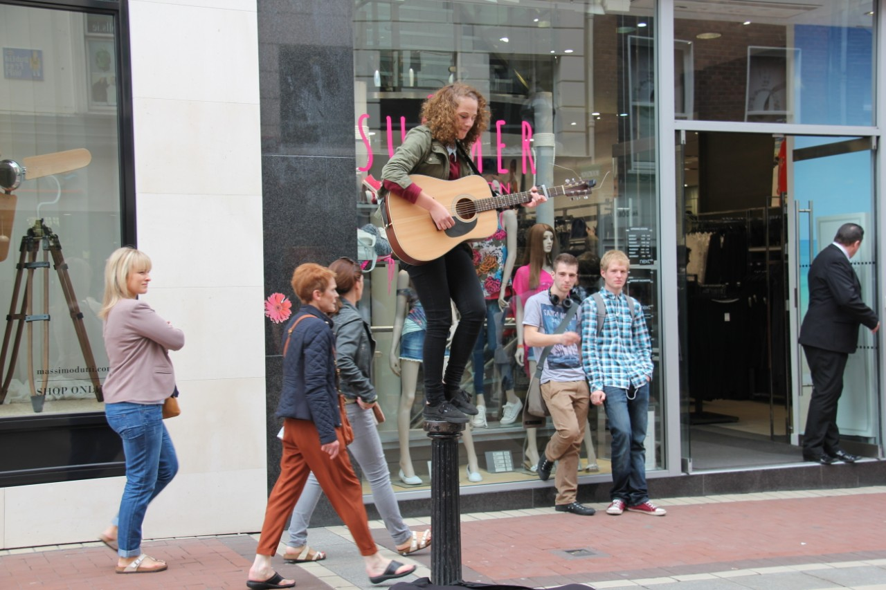 Busker at the top of Grafton Street, 2014 by Jackie de Burca